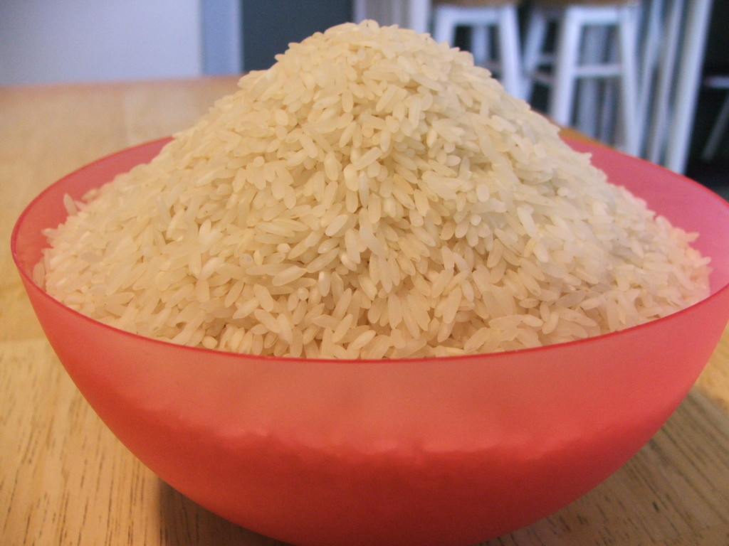 up close image of bowl of raw rice