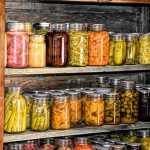 canned vegetables on shelves of root cellar