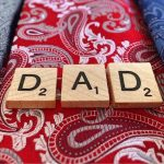 dad spelled out on red tie