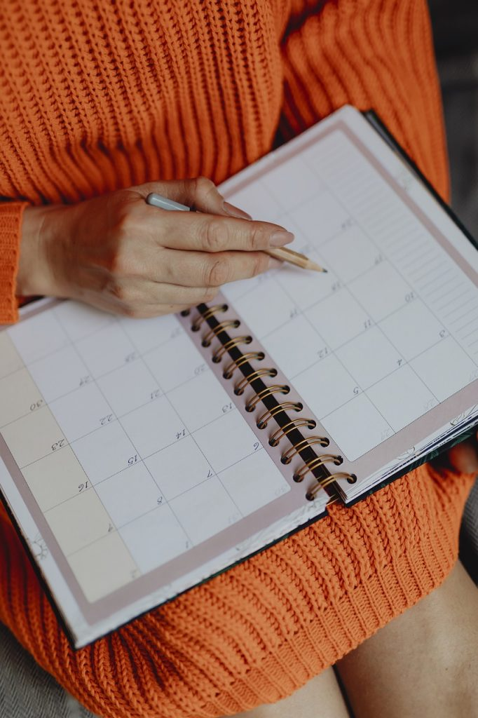 person using day planner