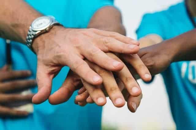 hands clasped indicating charity and donations