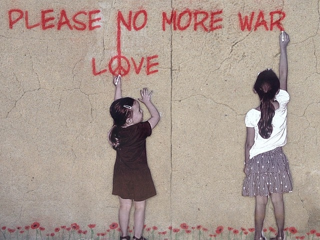 drawing of two children and words no more war, peace