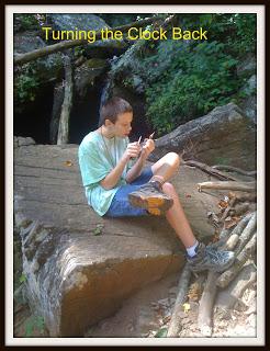boy sitting on rock during hike in georgia mountains