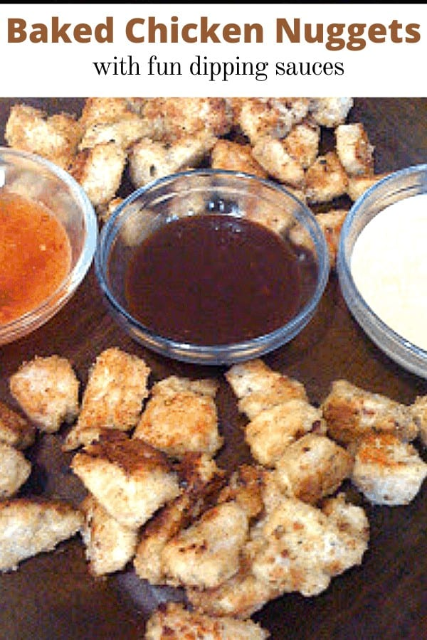 homemade chicken nuggets on a brown platter with dipping sauces