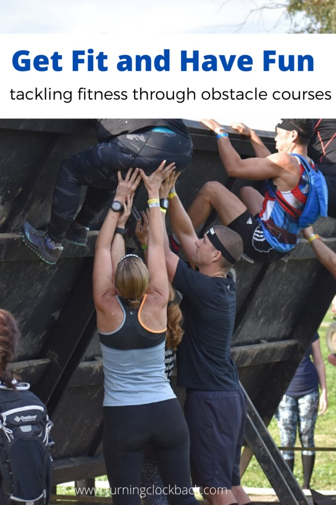 group of people tackling obstacle course with text Get Fit and Have Fun tackling fitness through obstacle courses