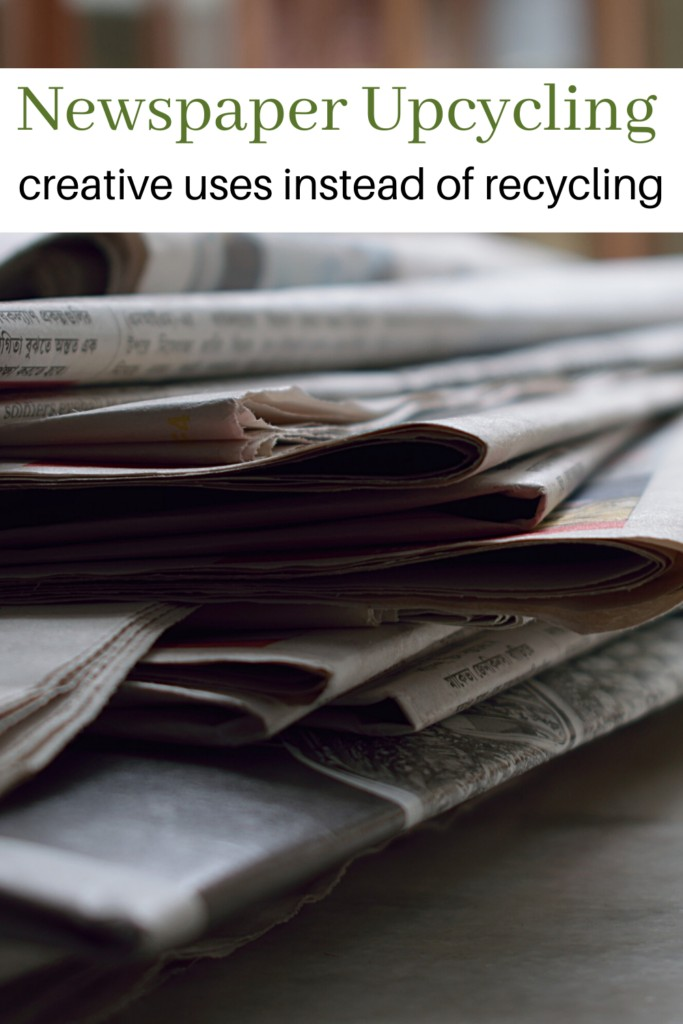 pile of old newspaper with text overlay 'Newspaper Upcycling creative uses instead of recycling'