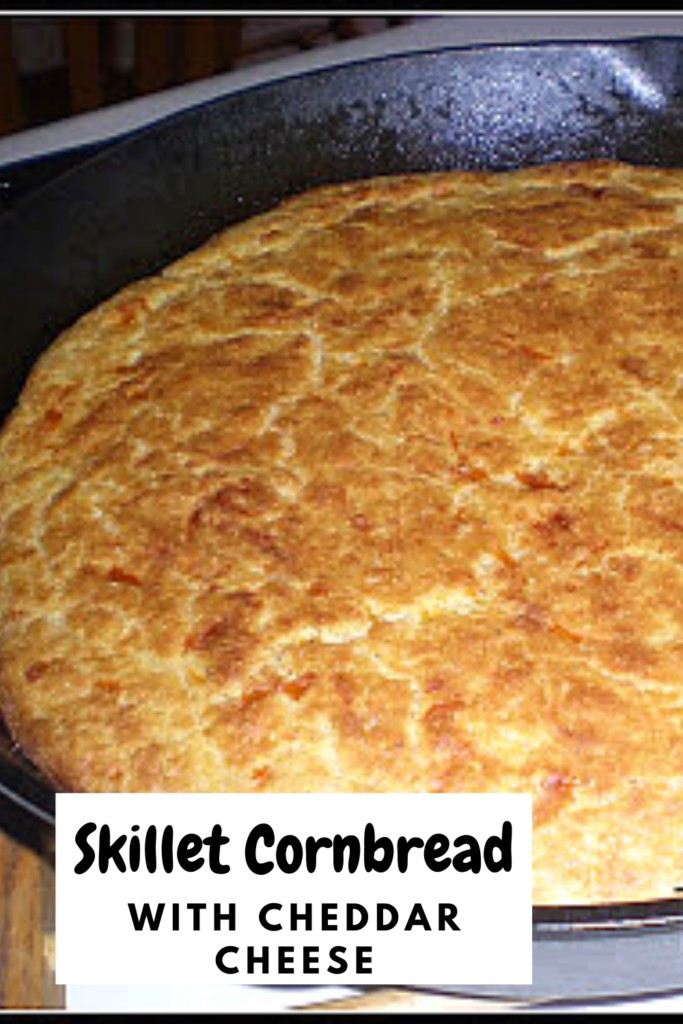 homemade cornbread in a cast iron skillet with text overlay 'Skillet Cornbread with Cheddar Cheese'