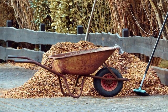 wood mulch in a wheel barrow