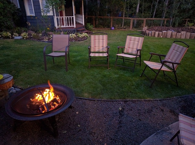 outdoor fire pit with chairs around it