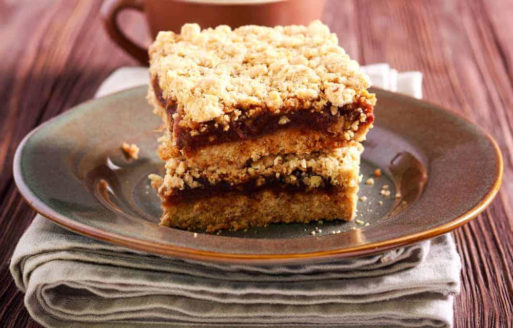 Fig bars with oat crumble topping on plate