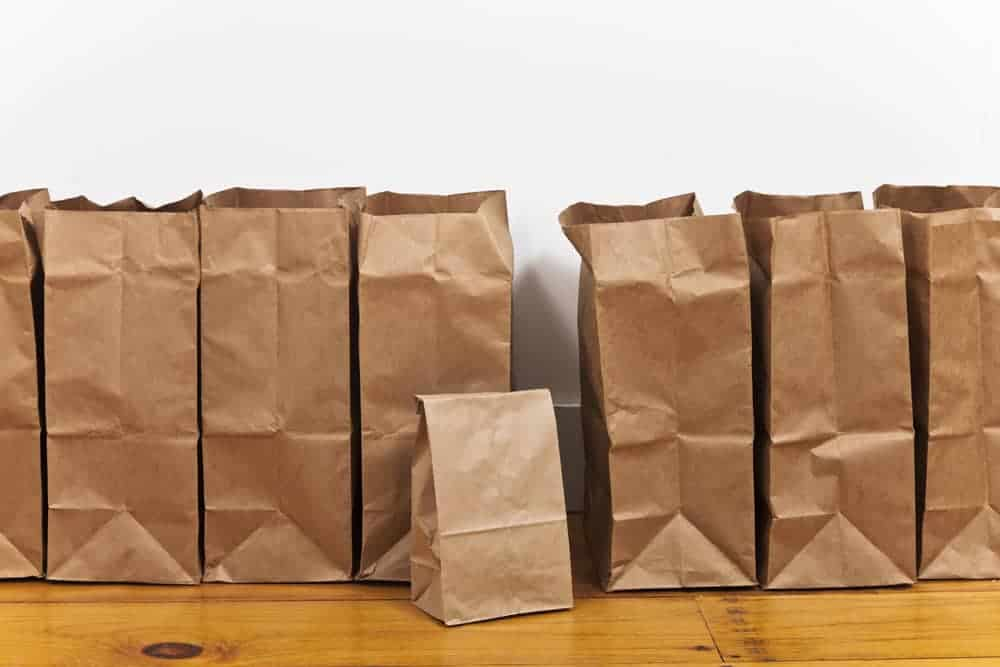 A row of brown paper bags