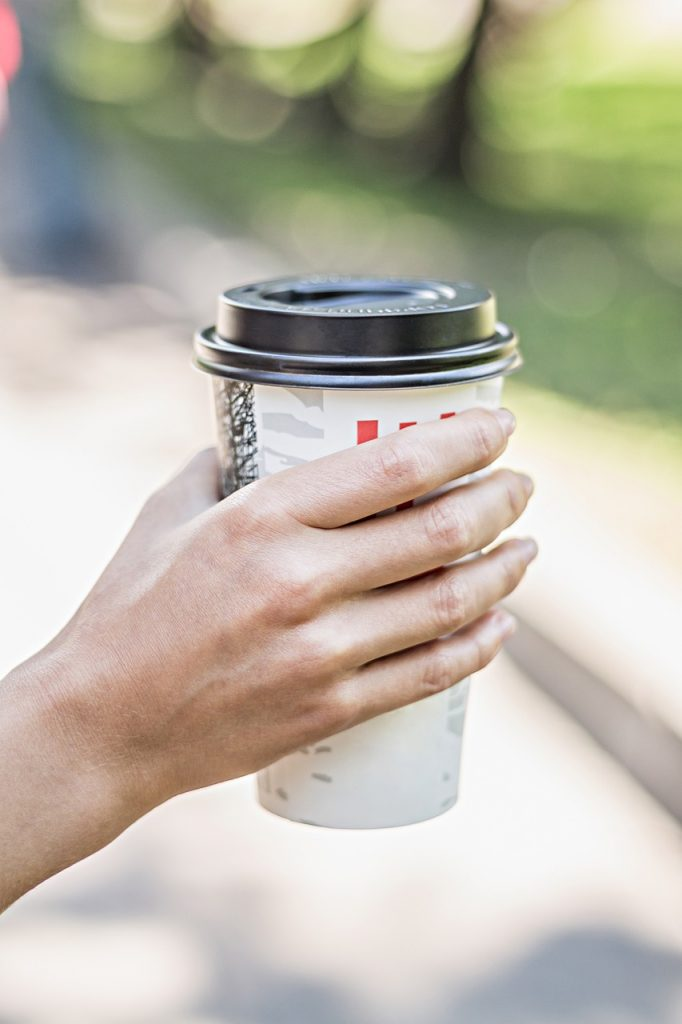 hand holding disposable cup
