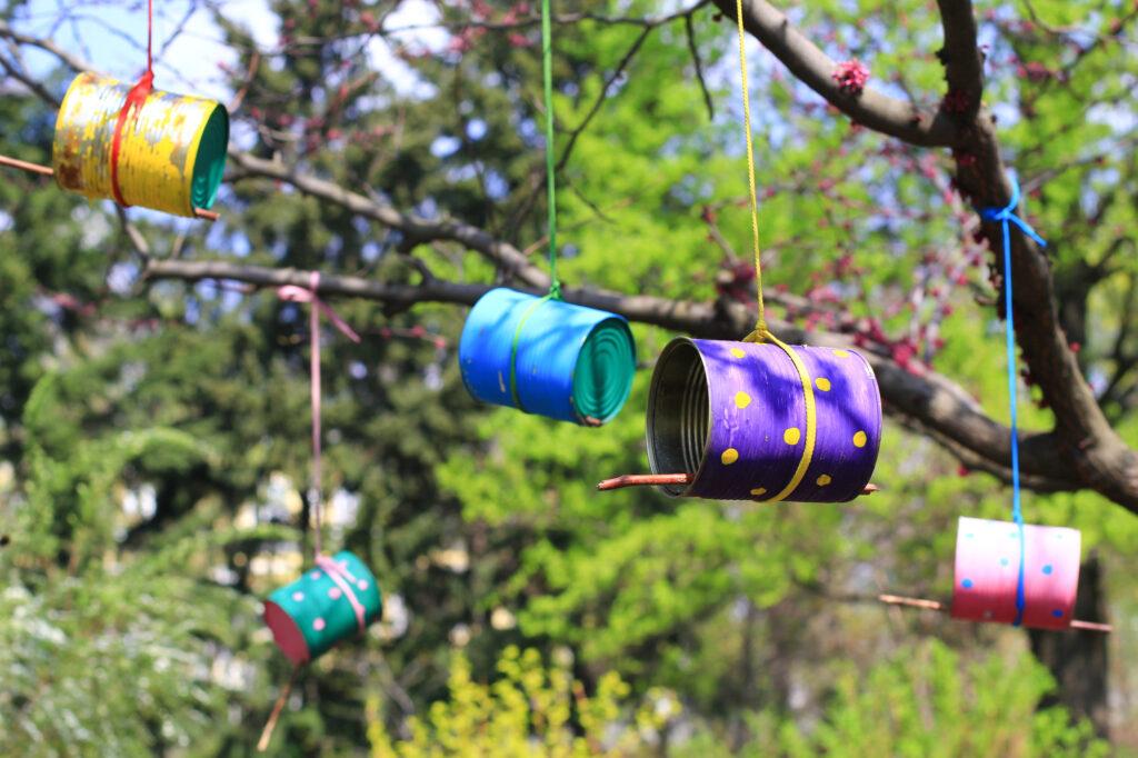 tin can bird feeders in a tree