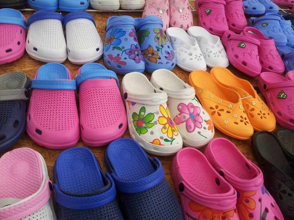 collection of gardening shoes in many colors