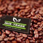 fair trade stamp against coffee beans