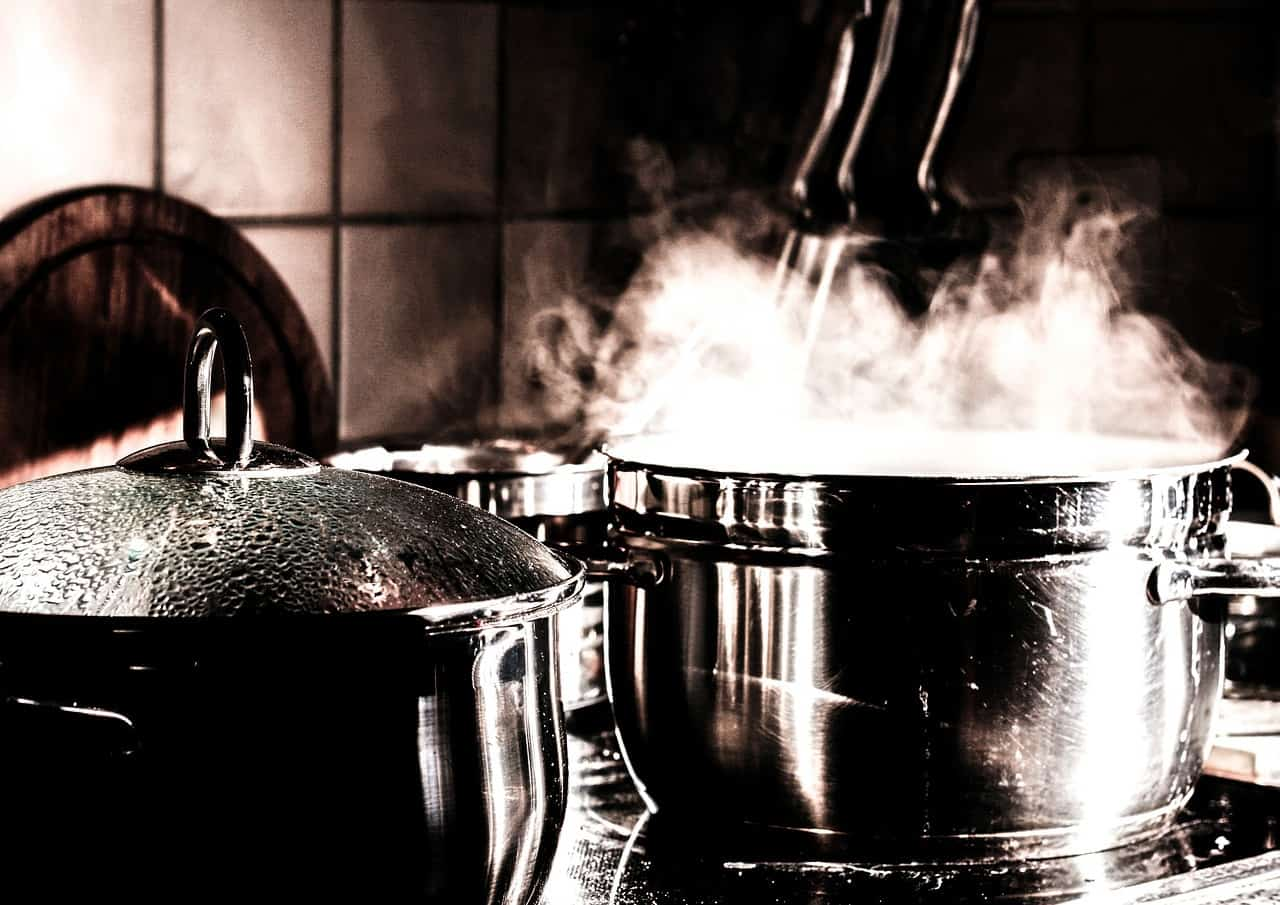 pot simmering on stove to indicate hot kitchen