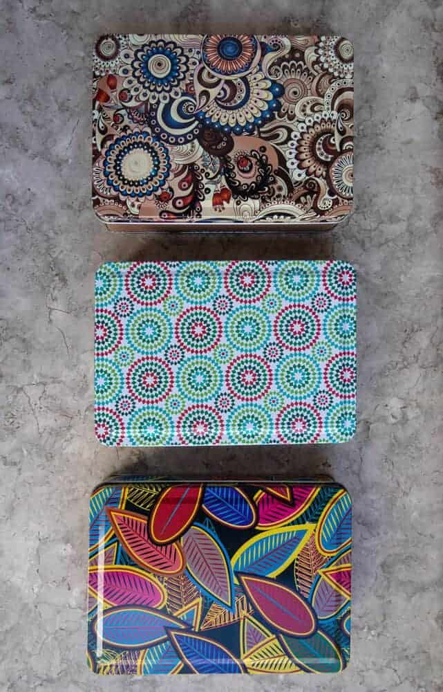 Multi-colored metal boxes. Boxes for little things. Gift boxes