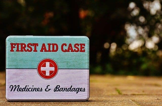 small first aid kit in small metal tin
