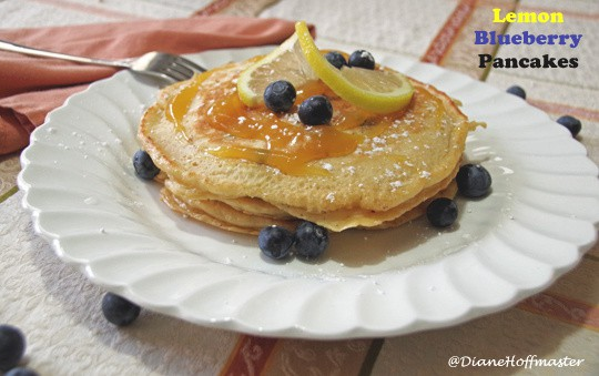 Plate of pancakes with lemon and fresh blueberries