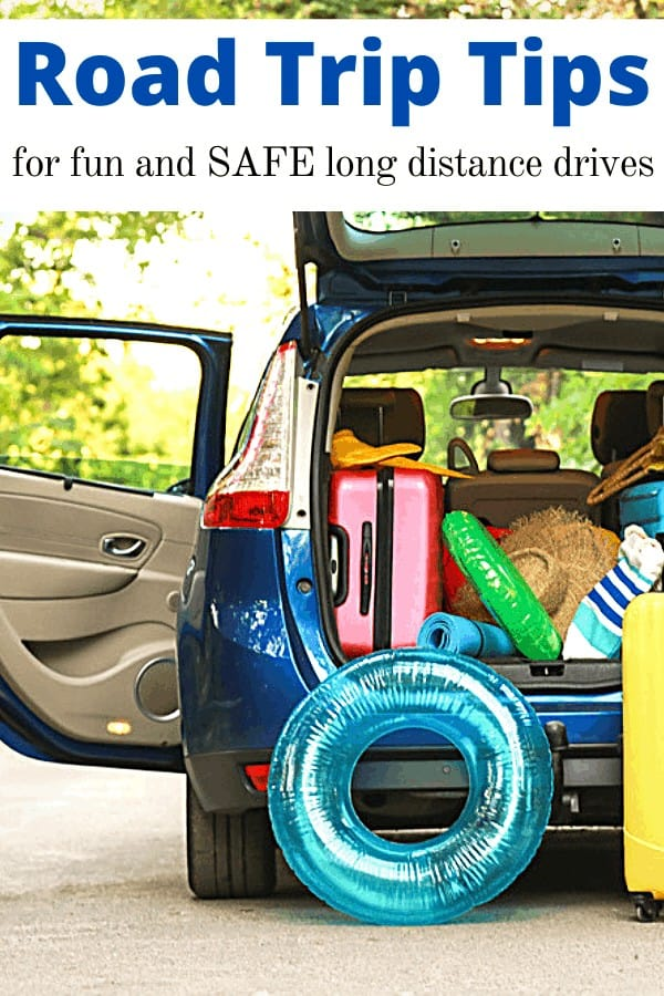 car packed with suitcases and beach raft and text overlay 'Road Trip Tips for fun and SAFE long distance drives'