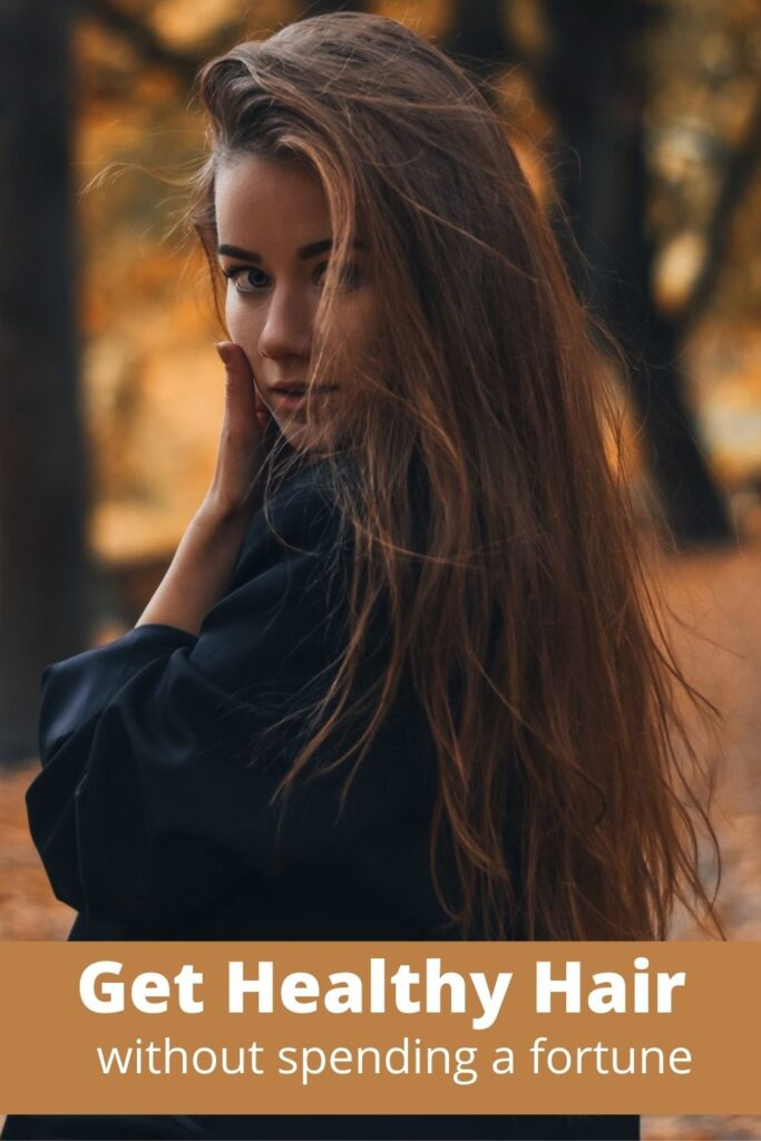 woman with beautiful brown hair outside in forest