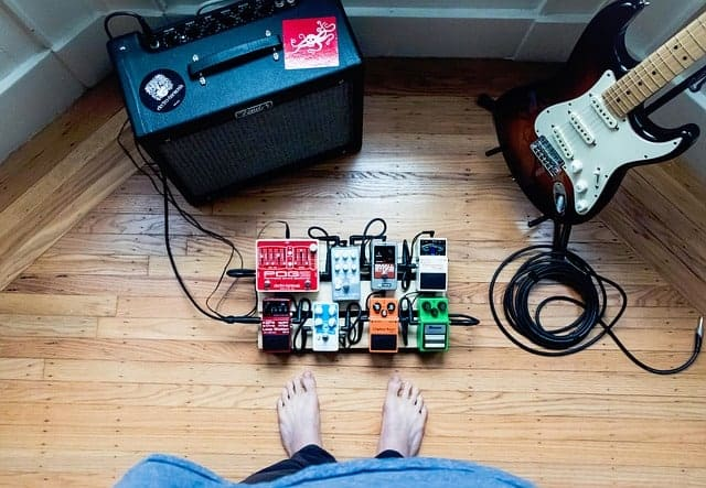 guitar, amplifier and electrical cords