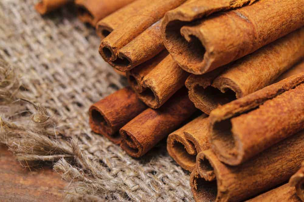 Closeup photo of cinnamon sticks on a linen cloth
