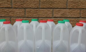 group of empty plastic milk containers