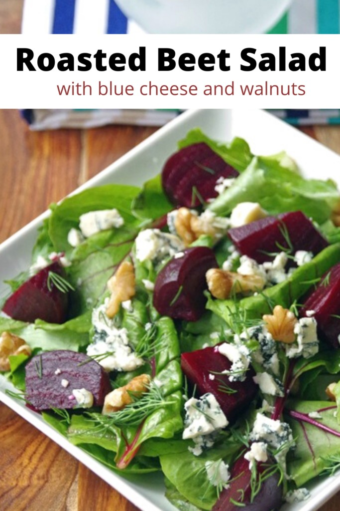 Roasted Beet Salad with blue cheese and walnuts on a white plate