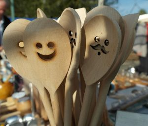 old wooden spoons carved with faces
