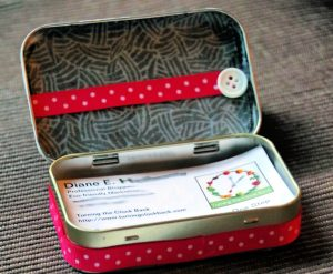 DIY business card holder from an upcycled Altoid tin