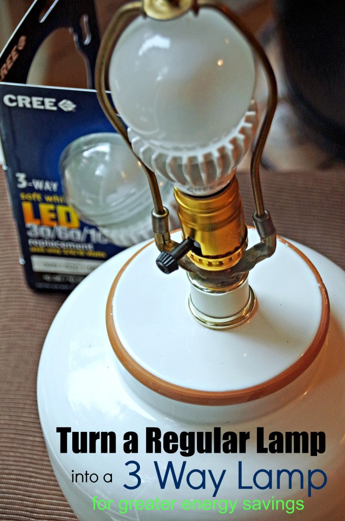 close up of lamp socket with 3 way lightbulb in back and text overlay 'How to turn a regular lamp into a 3 way lamp'