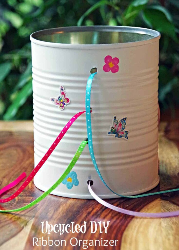 tin can upcycled into ribbon organizer with thin ribbon in it