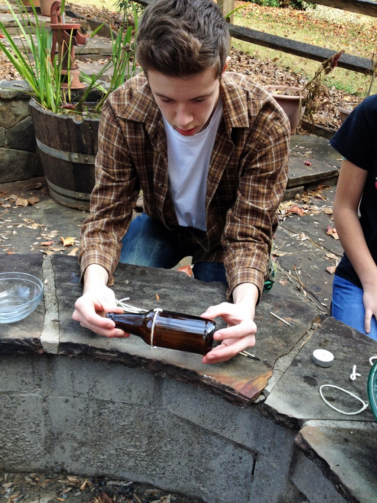 How to cut a wine bottle with string and fire