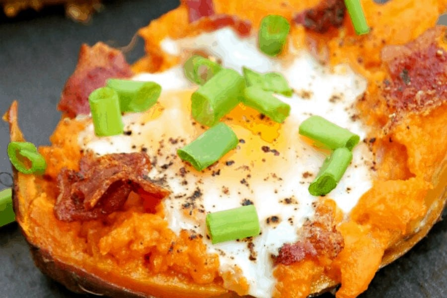 baked sweet potato with egg bacon and green onions