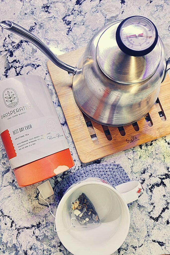 prosperatea best day ever wellness blend on counter with teapot and mug
