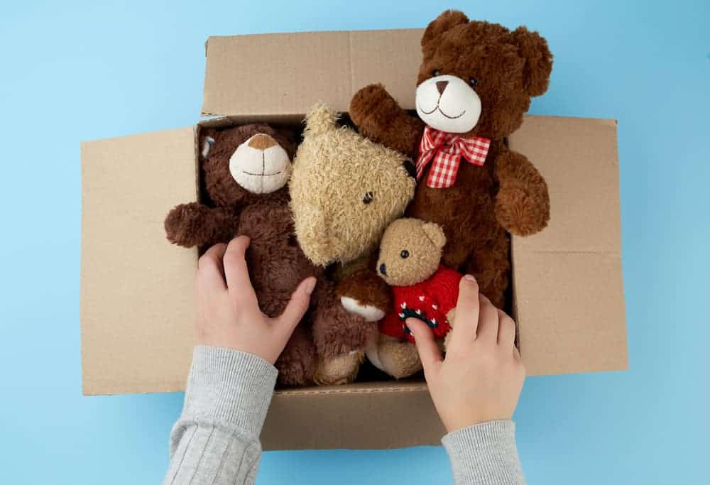 brown cardboard box with various stuffed animals