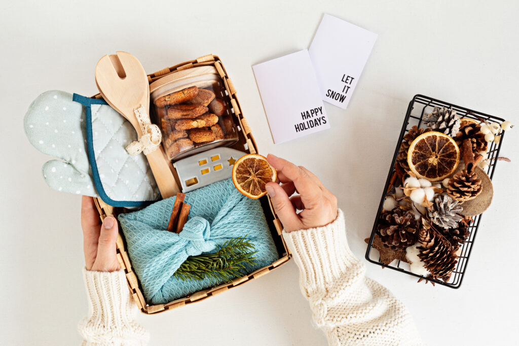 Preparing care package, seasonal gift box with kitchen utensils,