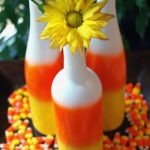 Need DIY Halloween Centerpieces? Make Upcycled Candy Corn Wine Bottles!