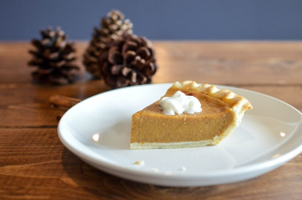 slice of homemade pumpkin pie on a white plate