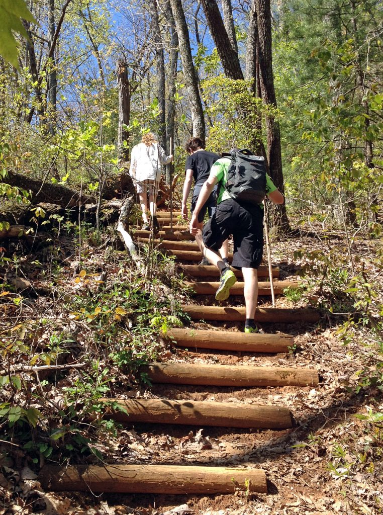 people hiking up stairs on outdoor trail for an outdoor workout