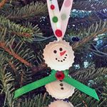 Try this Eco Friendly Christmas Craft:  Bottle Cap Snowmen!