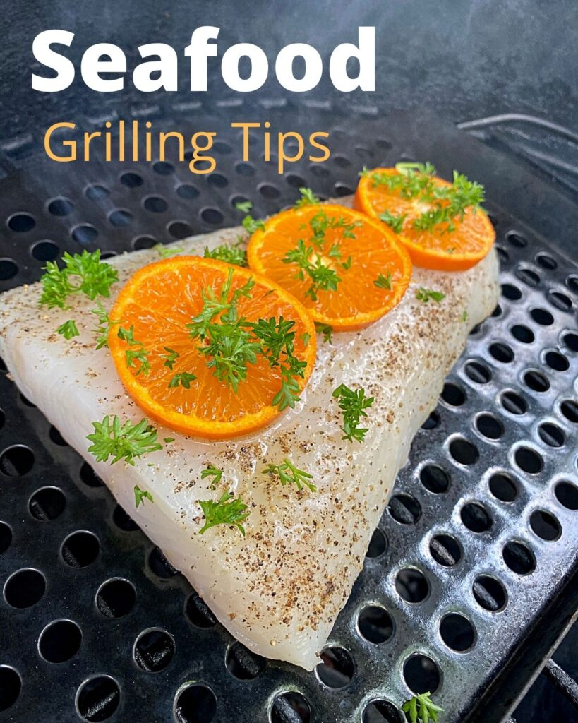 fish fillet on the grill with orange slices and parsley