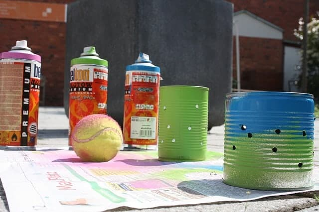 old tennis ball, spray paint and old tin cans for crafts