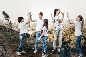 Positive joyful team giving each other high fives