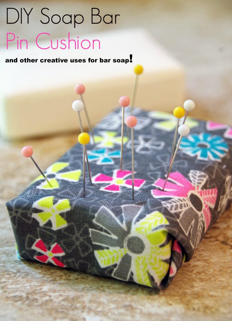 pin cushion made out of an old bar of soap with pins in it