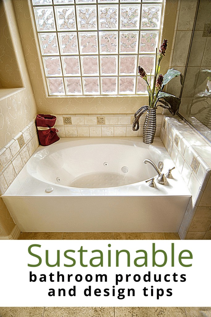 eco friendly bathroom with tub and windows and text overlay 'Sustainable bathroom products and design tips'