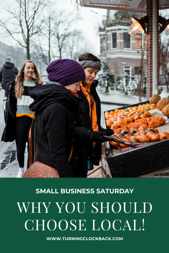 Two women shopping at a farmers market and the text Why you should choose local on Small Business Saturday