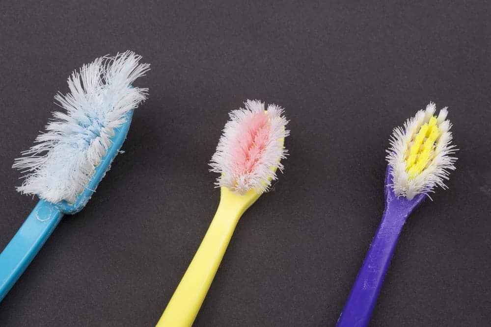 brightly colored Used toothbrushes