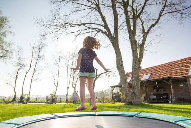 kid exercising on trampoline